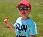 Cute young boy with dirty shirt and a ringpop Royalty Free Stock Photo