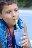 Cute young boy drink juice Royalty Free Stock Photos