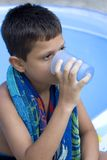 Cute young boy drink juice stock images