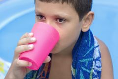 Cute young boy drink juice Stock Photo