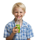 Cute young boy drinking green smoothie Royalty Free Stock Image