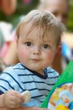 Cute young boy eating Stock Image