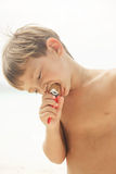 Cute young boy eating ice cream Royalty Free Stock Image