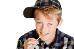 Cute young boy eating a lollipop Royalty Free Stock Photos