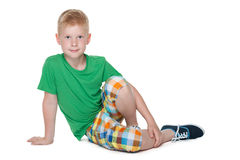 Cute young boy in the green shirt Stock Photos