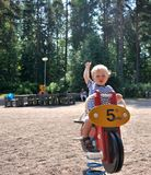 A cute young boy having fun on the playground Royalty Free Stock Image