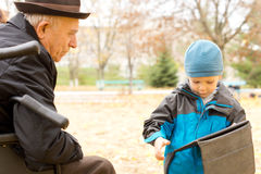 Cute young boy with his grandfather Royalty Free Stock Photo