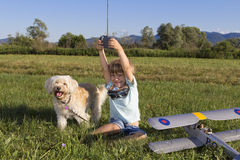 Cute young boy and his RC plane Stock Photos