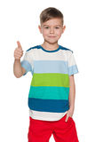 Cute young boy holds his thumb up Royalty Free Stock Image