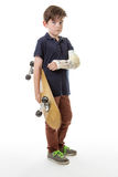 Cute young boy holding a skateboard Royalty Free Stock Images