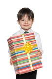 Cute young boy holds a gift box Stock Image
