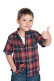 Cute young boy holds his thumb up Stock Photo