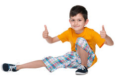 Cute young boy holds his thumbs up Stock Images