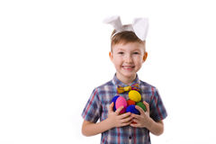 Cute young boy in image of an Easter bunny with eggs Stock Photos