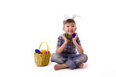Cute young boy in an image of an Easter bunny with eggs Royalty Free Stock Photo
