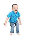 Cute young boy jumping Royalty Free Stock Image