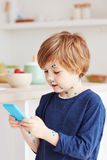 Cute young boy, kid having chicken pox, that is cured with brilliant green antiseptic at home Stock Image