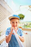 Cute young boy, kid helps father with renovation of wodden pergola wall on rooftop patio zone. Cute young boy, kid helps father with renovation of wodden pergola Royalty Free Stock Photos