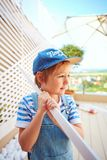 Cute young boy, kid helps father with renovation of wodden pergola wall on rooftop patio zone. Cute young boy, kid helps father with renovation of wodden pergola Stock Image