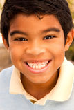 Cute young boy laughing and smiling. Happy cute young boy laughing and smiling Royalty Free Stock Image