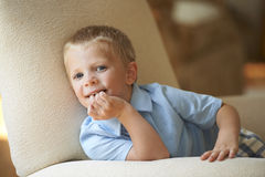 Cute Young Boy In Living Room Stock Image