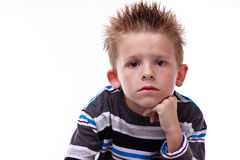Cute young boy looking bored Royalty Free Stock Photography