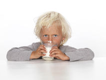 Cute, young boy with milk Royalty Free Stock Photos