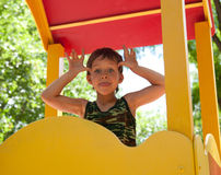Cute young boy on playground Stock Image