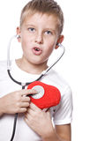 Cute young boy playing doctor Stock Photo