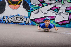Cute young boy playing on his skateboard Stock Photography