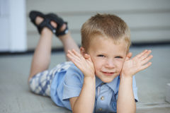 Cute Young Boy Playing On Porch Royalty Free Stock Photo