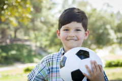 Cute Young Boy Playing with Soccer Ball in Park Royalty Free Stock Photos
