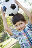 Cute Young Boy Playing with Soccer Ball in Park Stock Image