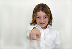 Cute Young Boy Pointing and Smiling Stock Photography
