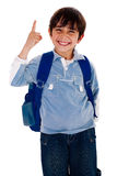 Cute young boy pointing upwards Royalty Free Stock Photos