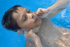 Cute young boy in pool royalty free stock photography