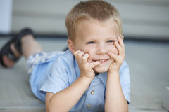 Cute Young Boy On Porch Stock Photo