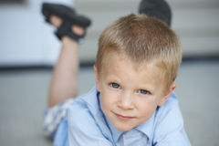 Cute Young Boy On Porch Stock Photos