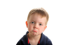 Cute young boy pouting royalty free stock photography