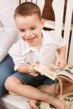 Cute Young Boy Reading His Book Stock Photos
