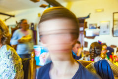 Cute young boy in a restaurant shaking  head Stock Image