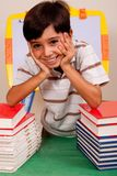 Cute young boy resting on books Stock Photos