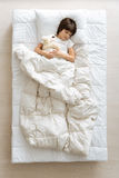 Cute young boy resting under blanket Royalty Free Stock Image