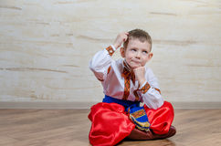 Cute young boy sitting thinking Stock Photography