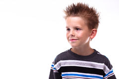 Cute young boy smiling looking off camera Stock Photo