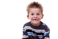 Cute young boy smiling and missing teeth. Cute little boy smiling and showing his missing teeth on a white background Stock Photos