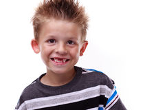 Cute young boy smiling and missing teeth. Cute little boy smiling and showing his missing teeth on a white background Stock Images