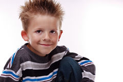 Cute young boy smiling at the viewer Stock Image