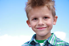 Cute young boy smiling at the viewer Royalty Free Stock Photos