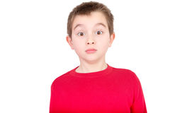 Cute young boy staring in amazement stock images